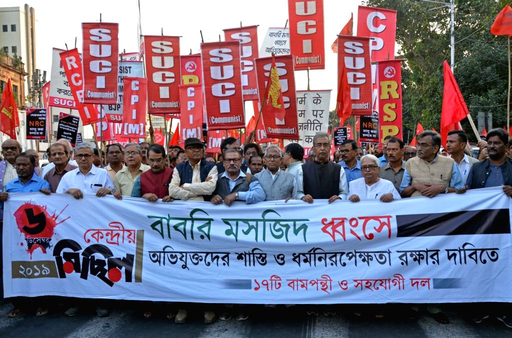 Left Front Chairman Biman Bose and CPI-M leader Surjya Kanta Mishra lead a protest rally against the demolition of Babri mosque, on the anniversary of the mosque's demolition, in Kolkata on ... - Biman Bose and Surjya Kanta Mishra