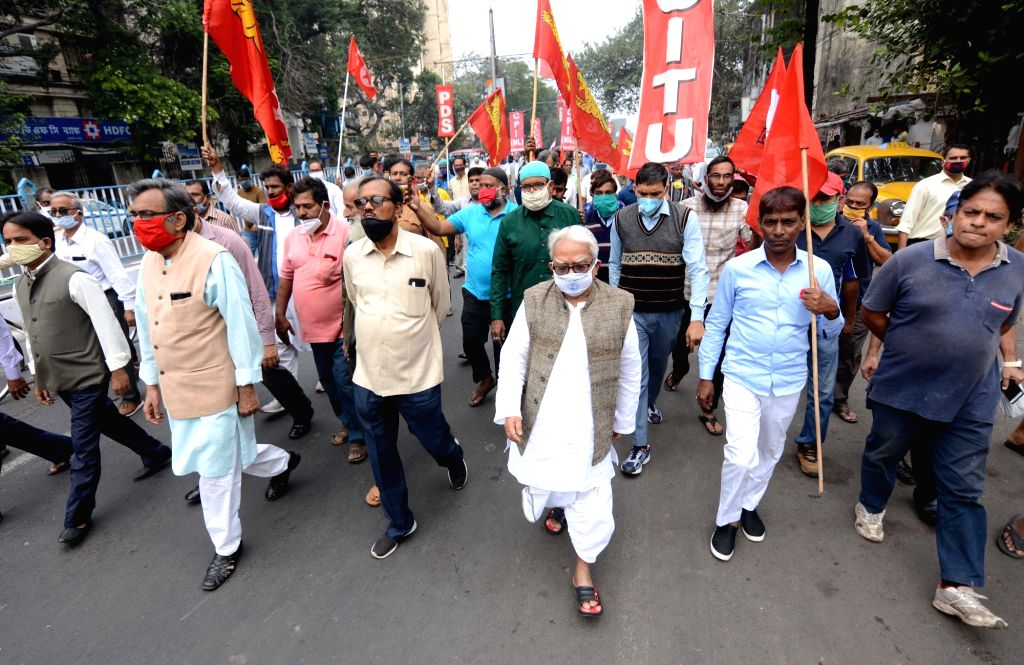 Left Front Chairman Biman Bose and CPI-M State Secretary Surja Kanta Misra lead a protest rally during the 24-hour nationwide trade union strike called by the central trade unions against ... - Biman Bose