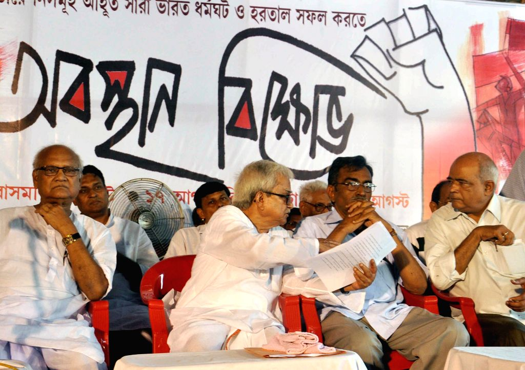 Left Front Chairman Biman bose and CPI(M) West Bengal Secretary Surya Kanta Mishra during a demonstration against West Bengal Government in Kolkata, on Aug 17, 2015.