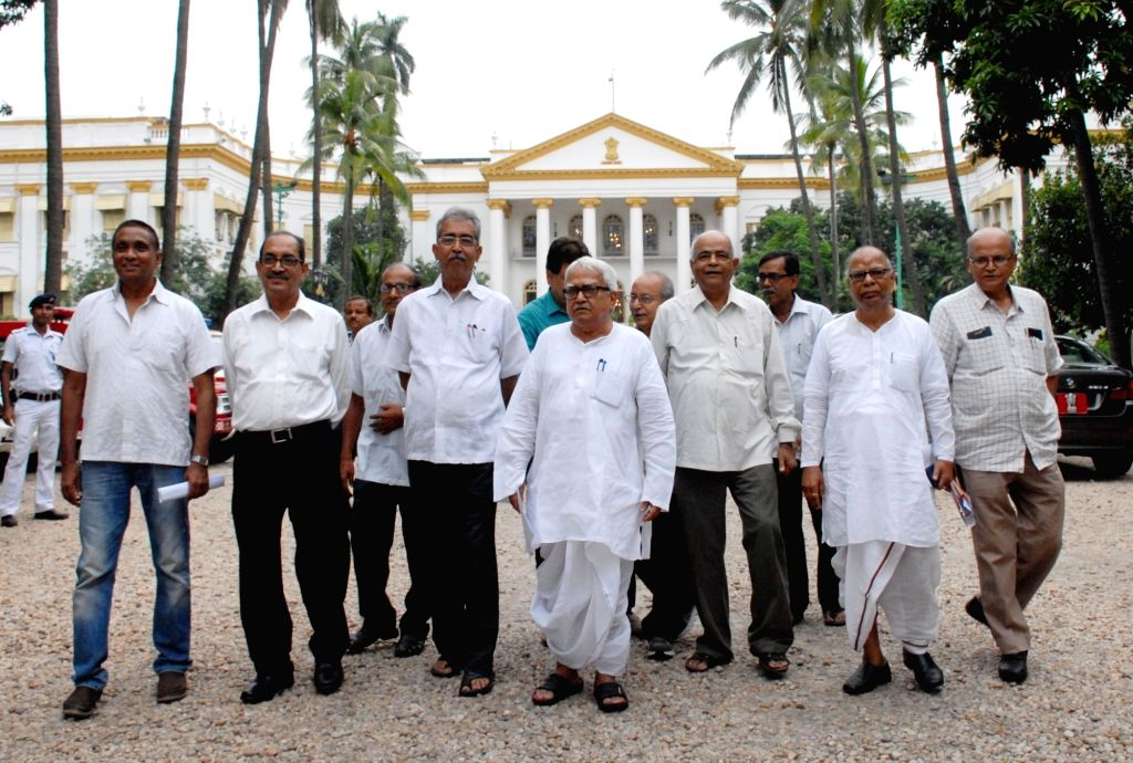 Left Front Chairman Biman Bose and other left leaders come out after meeting West Bengal Governor Keshari Nath Tripathi at Raj Bhawan in Kolkata, on July 5, 2017. - Biman Bose and Keshari Nath Tripathi