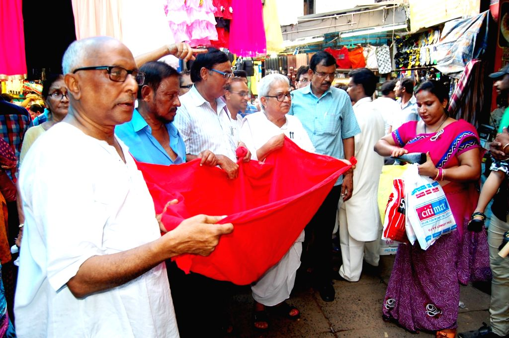 Left Front chairman Biman Bose collects funds from people on the streets of Kolkata on June 23, 2016. - Biman Bose