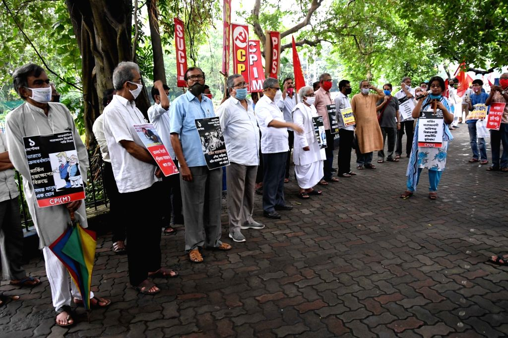 Left front Chairman Biman Bose, CPI-M's West Bengal State secretary Surja Kanta Mishra and other party leaders participate in a rally organised to observe anti-Imperialism day while ... - Biman Bose and Surja Kanta Mishra