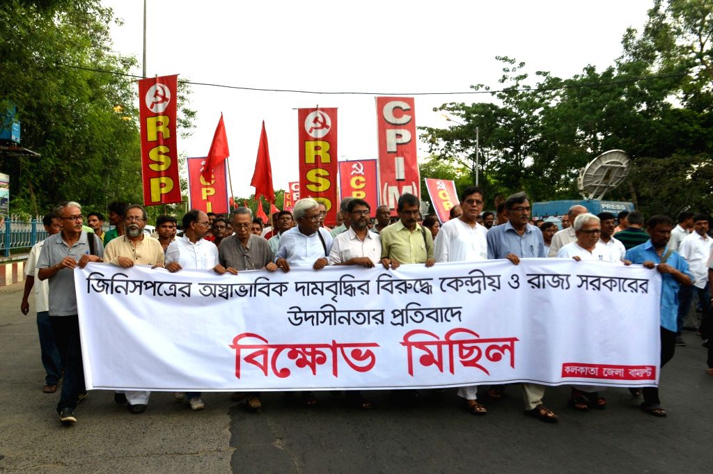 Left Front Chairman Biman Bose, CPI-M State secretory Surja Kanta Mishra and other leaders take part during a protest rally against the price hike of commodities in Kolkata, on June 22, 2016. - Biman Bose and Surja Kanta Mishra