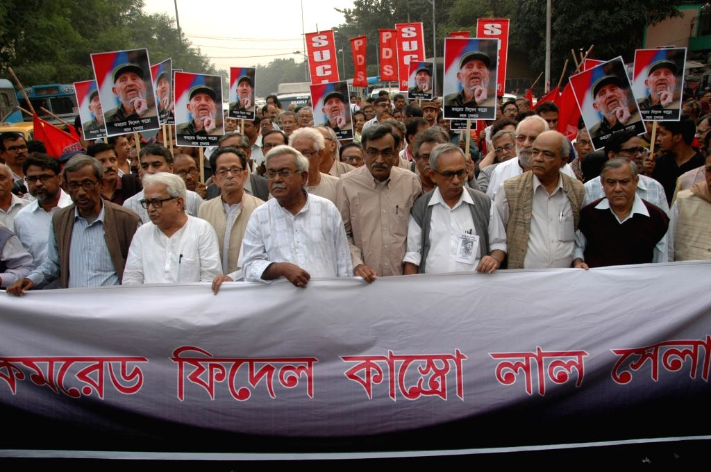 Left front Chairman Biman Bose, CPI(M) State Secretory Surya Kanta Mishra with others leaders participate in a rally to pay tribute to Cuban leader Fidel Castro in Kolkata on Nov 26, 2015. ... - Biman Bose
