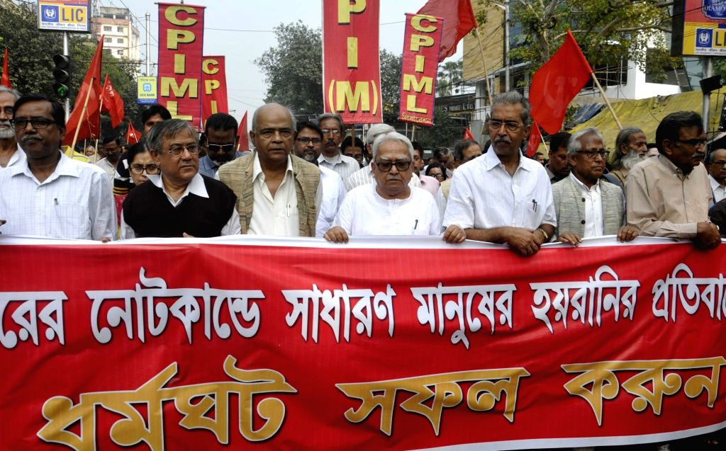 Left front Chairman Biman Bose, CPI(M) State Secretory Surya Kanta Mishra with others leaders participate in a march against demonetisation in Kolkata on Nov 28, 2016. - Biman Bose