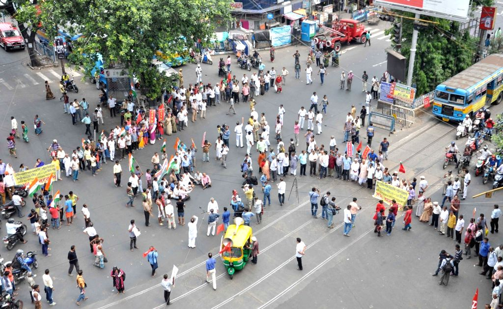 Left front chairman Biman Bose, CPI-M state secretory Surja Kanta Mishra along with Leftist trade union leaders and activists block the streets as they stage a demonstration against fuel ... - Biman Bose and Surja Kanta Mishra