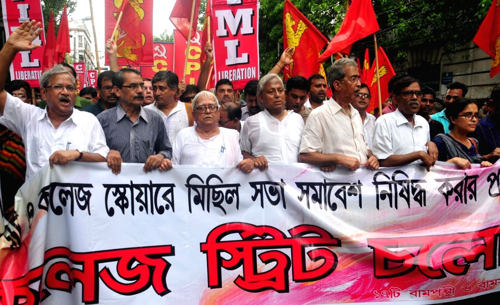 Left front Chairman Biman Bose leads a protest rally against  West Bengal Government's decision to impose bar on rally and meeting in College street area in Kolkata on Jul 4, 2017. - Biman Bose