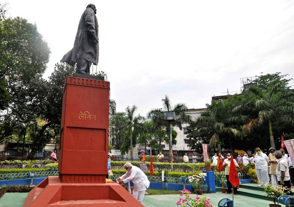 Left front Chairman Biman Bose wearing a mask pays tributes to Vladimir Lenin on his birth anniversary in Kolkata amid the extended nationwide lockdown imposed to mitigate the spread of ... - Biman Bose