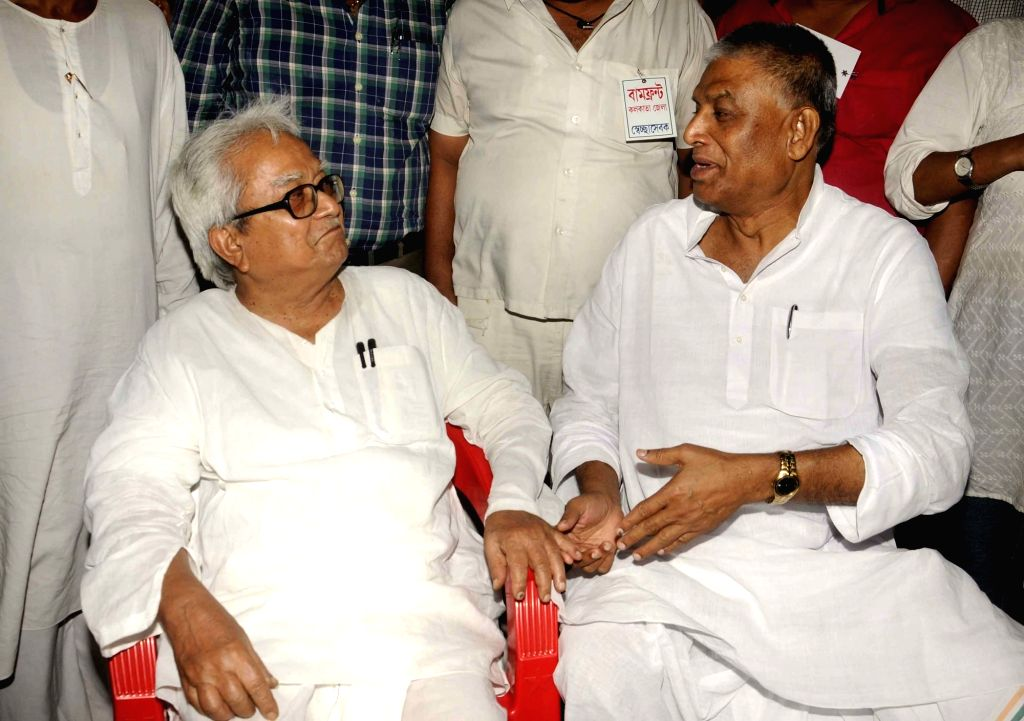 Left Front Chairman Biman Bose with Congress leader Abdul Mannan during a demonstration against West Bengal government in Kolkata, on May 25, 2016. - Biman Bose