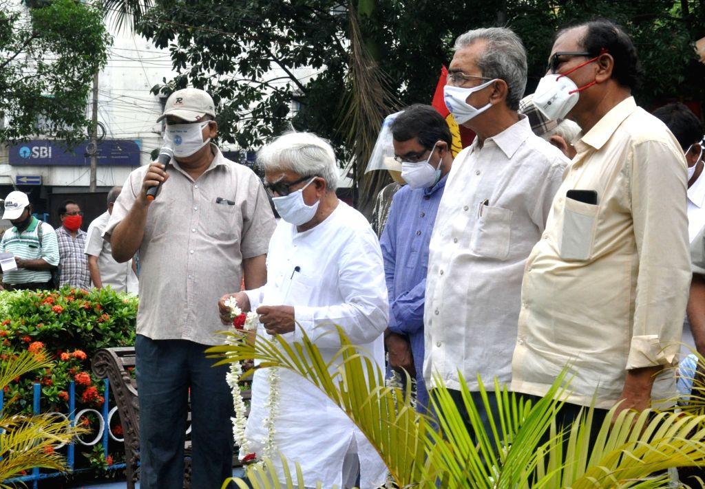 Left front Chairman Biman Bose with leftist activists and leaders observe Vladimir Lenin birth anniversary in Kolkata. - Biman Bose