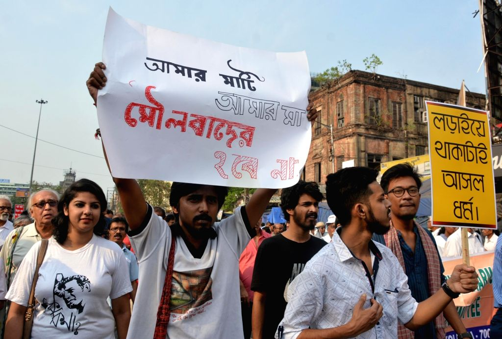Left intellectuals participate in a rally to protest against violence in the form of recent communal clashes across West Bengal, in Kolkata on April 8, 2018.