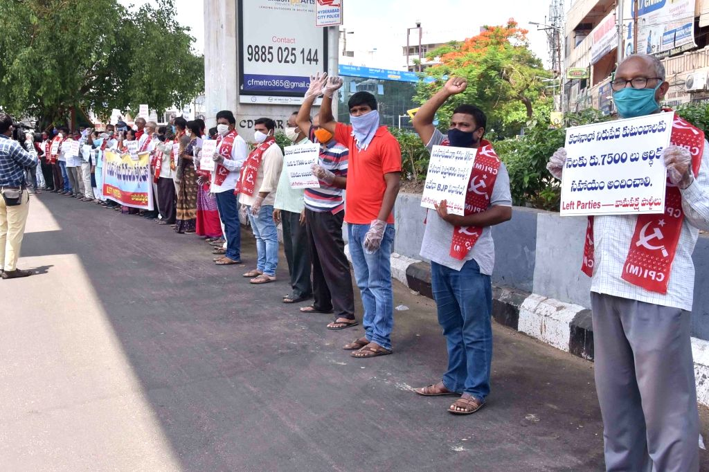 Left party activists stage a demonstration against hike in the prices of petrol and diesel, in Hyderabad on June 25, 2020.