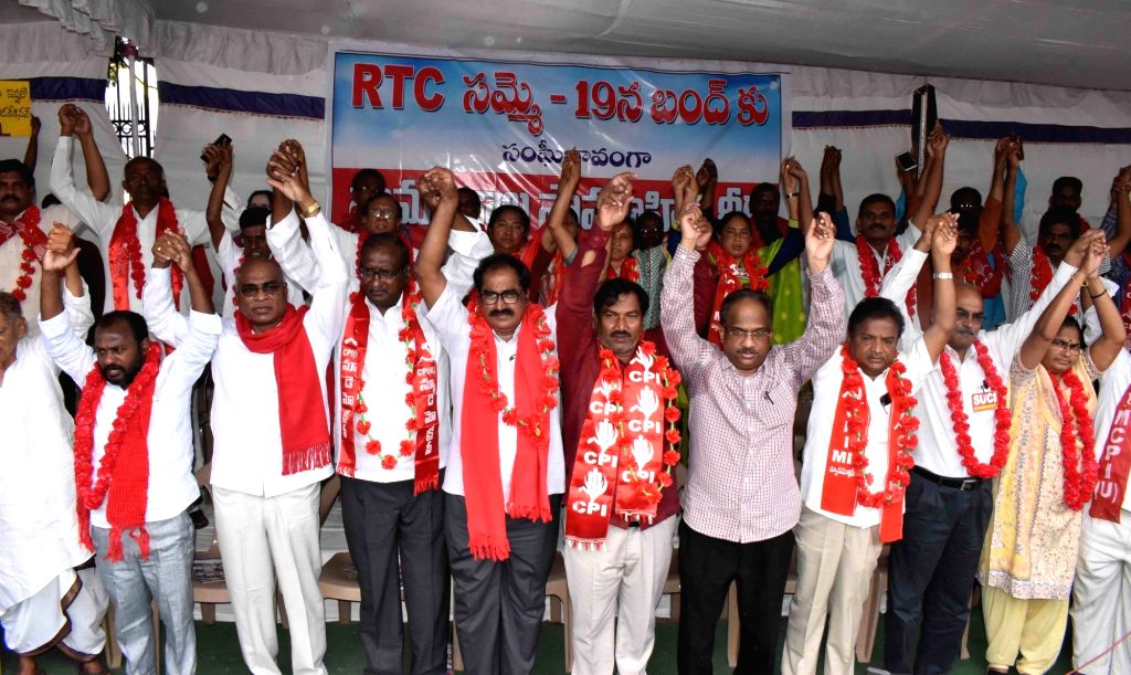 Left party workers form a human chain as they come out in solidarity with the strike of employees of the Telangana State Road Transport Corporation (TSRTC), which entered its 13th day, in ...