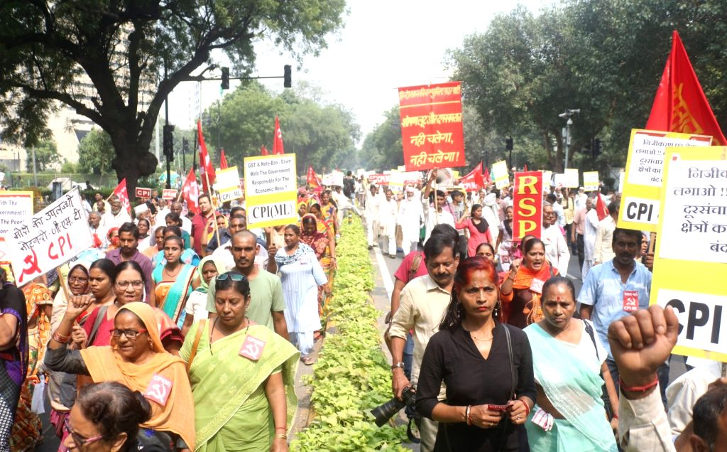 Left party workers participate in a protest rally organised on 'deepening economic crisis and growing misery of the people', in New Delhi on Oct 16, 2019.