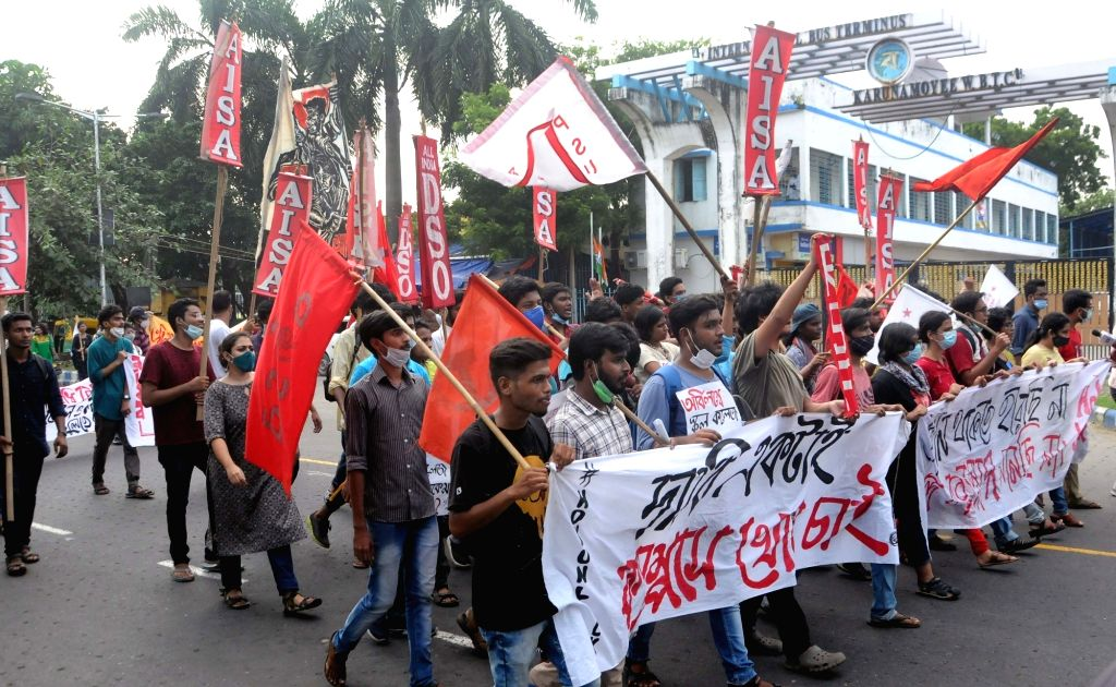 """Left Students Union activists took part in a protest rally during their """"Bikash Bhawan Abhijan"""" to demand for free vaccination for all students and re-open School, college and ..."""