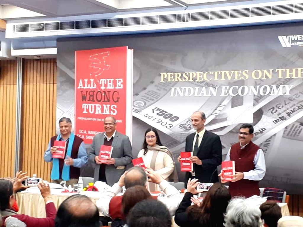 """(Left to right) Authors T.C.A. Srinivasa Raghavan, T.C.A. Ranganathan; Moderator Puja Gupta; economists Ajit Ranade and Rajat Kathuria at the launch of """"All The Wrong Turns"""". - Puja Gupta"""