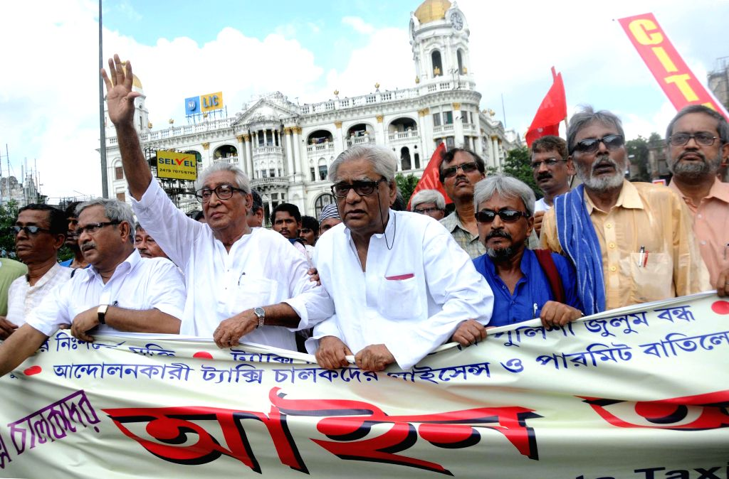Left Trade Union leaders participate in a rally to protest against atrocities of Bengal Police in Kolkata on Aug 11, 2014.