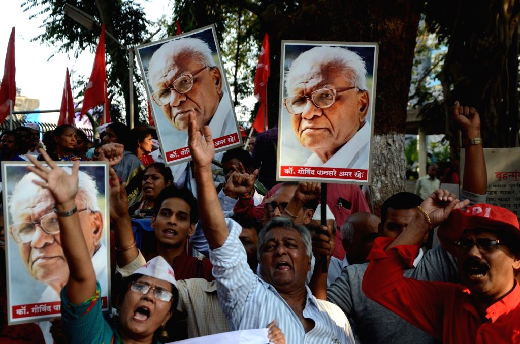 Leftist activists participate in a march on the death anniversary of late Communist Party of India (CPI) leader Govind Pansare in Mumbai on Feb 20, 2019.