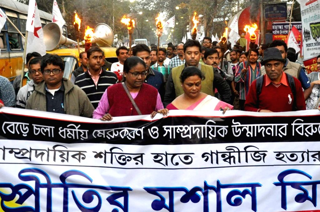 Leftist activists participate in a peace rally in Kolkata on Jan 30, 2018.