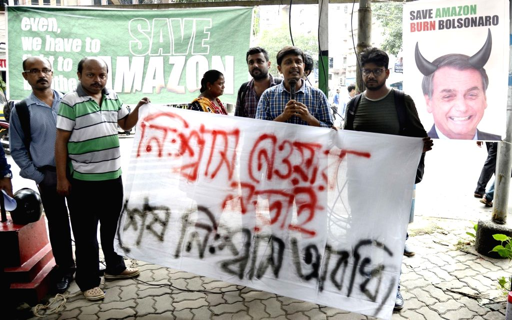 Leftist activists stage a protest against Brazilian President Jair Bolsonaro over Amazon fire; in Kolkata on Aug 27, 2019.