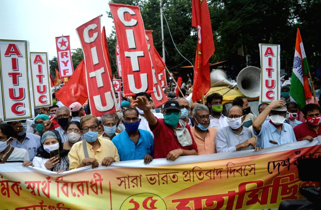 Leftist and Congress activists led by Left Front Chairman Biman Bose and Congress leader Abdul Mannan during 'Maha Michil' against the Central Government over the three contentious ... - Biman Bose