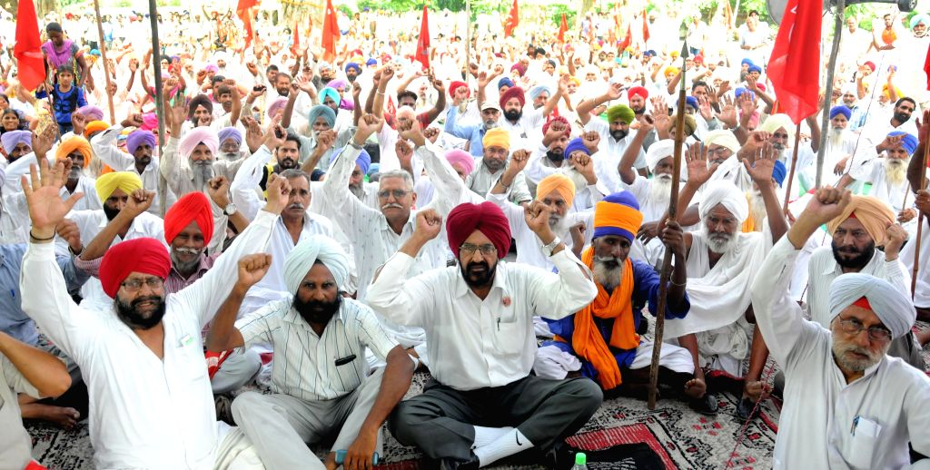 Leftists  stage a demonstration to press for their demands in Amritsar, on Aug 17, 2015.