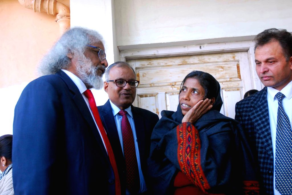 """Legal Advisor to Pakistan High Commission Abdul Rehman interacts with Mahammda, a mentally unsound destitute woman who claims to be a resident of """"Zila Gujarat"""" of Pakistan at Nari ..."""