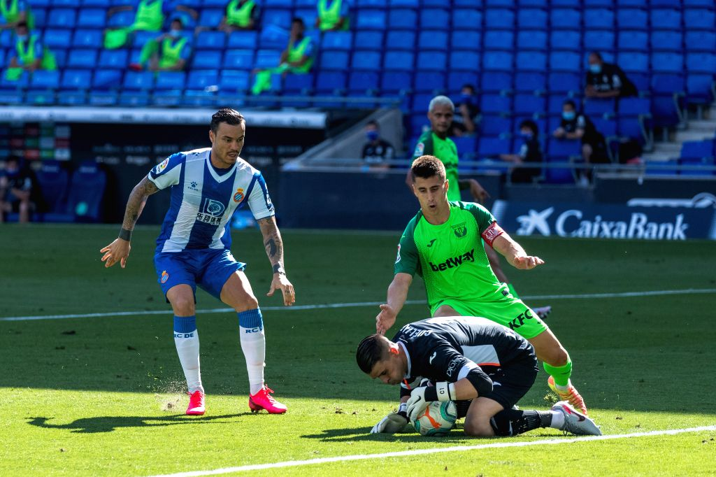 Leganes' goalkeeper Ivan Cuellar (R front) saves the ball during a Spanish league football match between RCD Espanyol and Leganes in Barcelona, Spain, July 5, 2020.