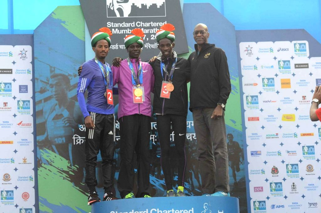 Legendary American athlete Edwin Moses with Second-placed runner Seboka Dibaba, winner Gideon Kipketer and third-placed Marius Kimutai after the Standard Chartered Mumbai Marathon 2016 on Jan ...