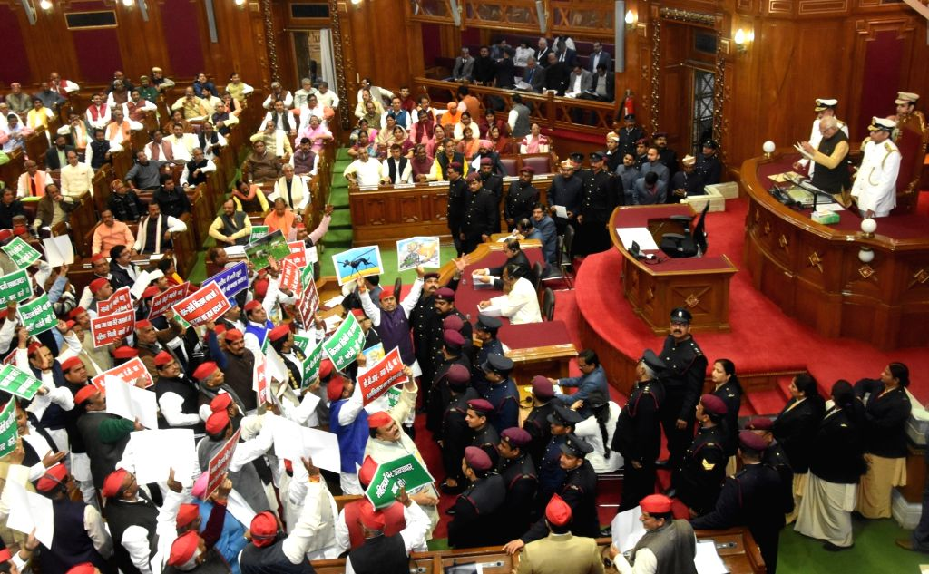 Legislators of Samajwadi Party (SP), Bahujan Samaj Party (BSP) and Congress create ruckus during Uttar Pradesh Governor Ram Naik's address at state assembly's budget session in Lucknow, on ...