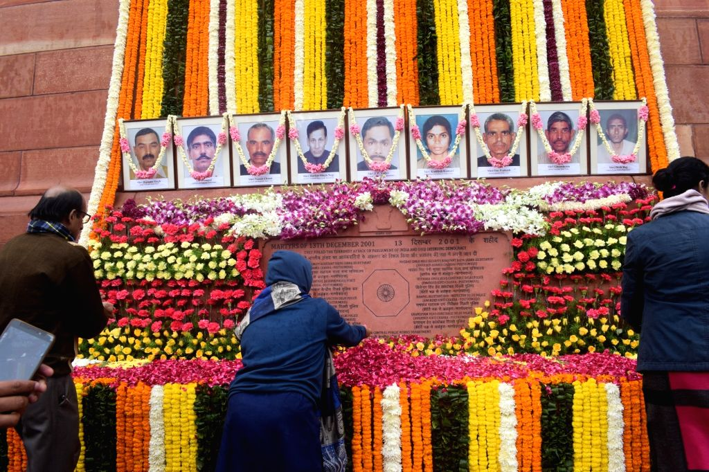Legislators pay tributes to the martyrs on 18th anniversary of Parliament attack at Parliament House in New Delhi on Dec 13, 2019.