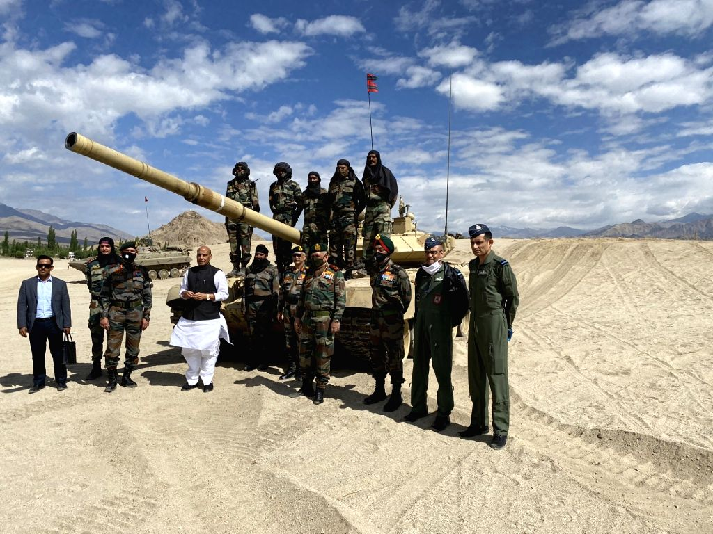 Leh: Defence Minister Rajnath Singh with the troops who participated in the para dropping and other military exercises at Stankna near Leh on July 17, 2020. Also seen Chief of Defence Staff General Bipin Rawat and Army Chief General Manoj Mukund Nara - Rajnath Singh