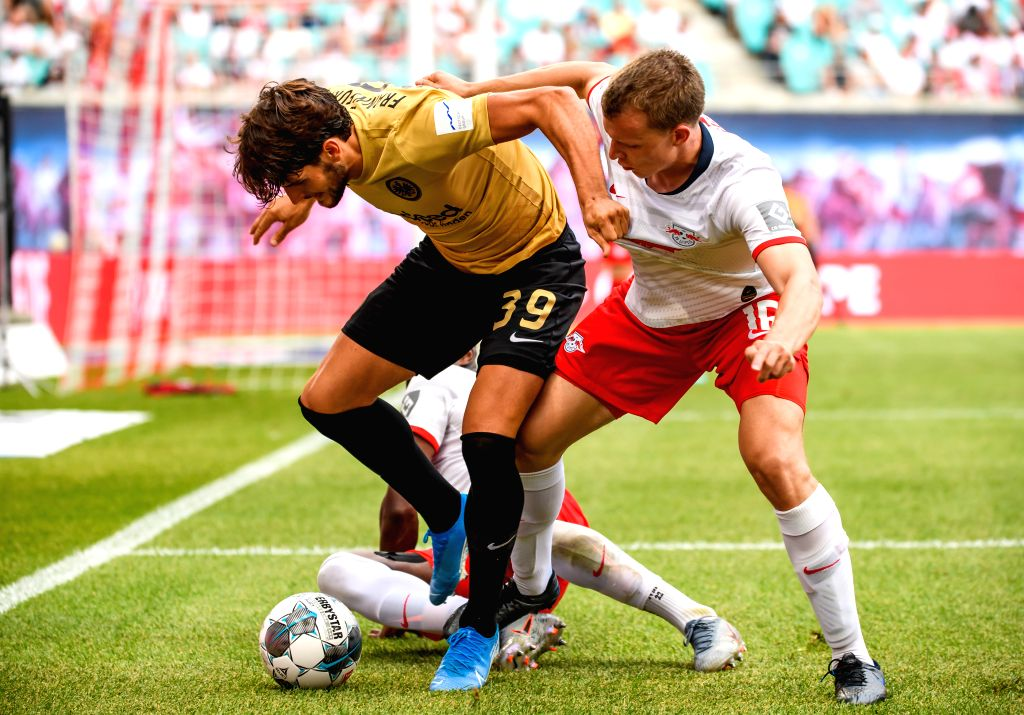 LEIPZIG, Aug. 26, 2019 - Goncalo Paciencia (L) of Frankfurt vies with Lukas Klostermann of Leipzig during a German Bundesliga match between RB Leipzig and Eintracht Frankfurt in Leipzig, Germany, on ...