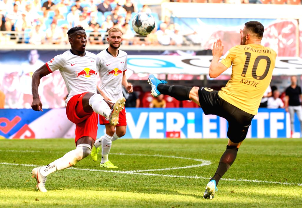 LEIPZIG, Aug. 26, 2019 - Nordi Mukiele (L) of Leipzig vies with Filip Kostic of Frankfurt during a German Bundesliga match between RB Leipzig and Eintracht Frankfurt in Leipzig, Germany, on Aug. 25, ...