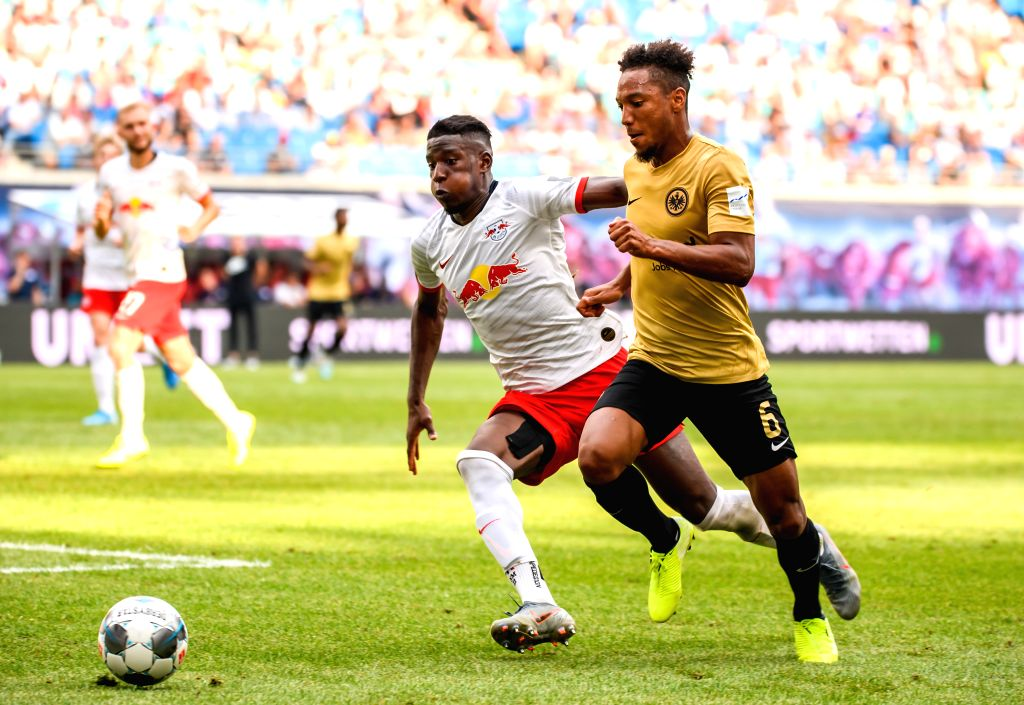 LEIPZIG, Aug. 26, 2019 - Nordi Mukiele (L) of Leipzig vies with Jonathan de Guzman of Frankfurt during a German Bundesliga match between RB Leipzig and Eintracht Frankfurt in Leipzig, Germany, on ...