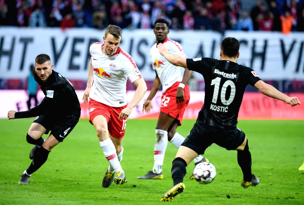 LEIPZIG, Feb. 10, 2019 - Leipzig's Lukas Klostermann (2nd L) passes the ball under the defense from Frankfurt's Filip Kostic (1st R) and Ante Rebic (1st L) during a German Bundesliga match between RB ...