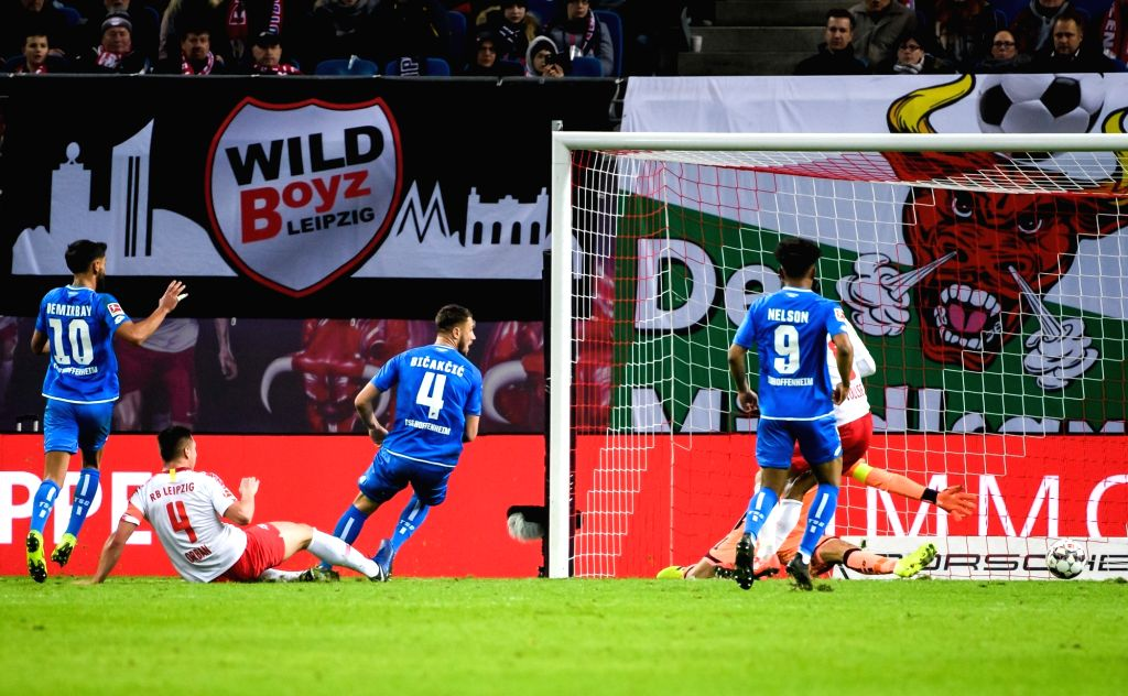 LEIPZIG, Feb. 26, 2019 (Xinhua) -- Leipzig's Willi Orban (2nd L) scores during a German Bundesliga match between RB Leipzig and TSG 1899 Hoffenheim in Leipzig, Germany, on Feb. 25, 2019. The match ended in a 1-1 draw. (Xinhua/Kevin Voigt/IANS)