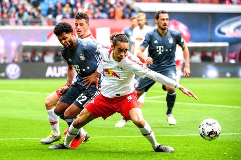 LEIPZIG, May 12, 2019 - Leipzig's Yussuf Poulsen (front R) vies with Bayern Munich's Serge Gnabry (front L) during a German Bundesliga match between RB Leipzig and FC Bayern Munich in Leipzig, ...