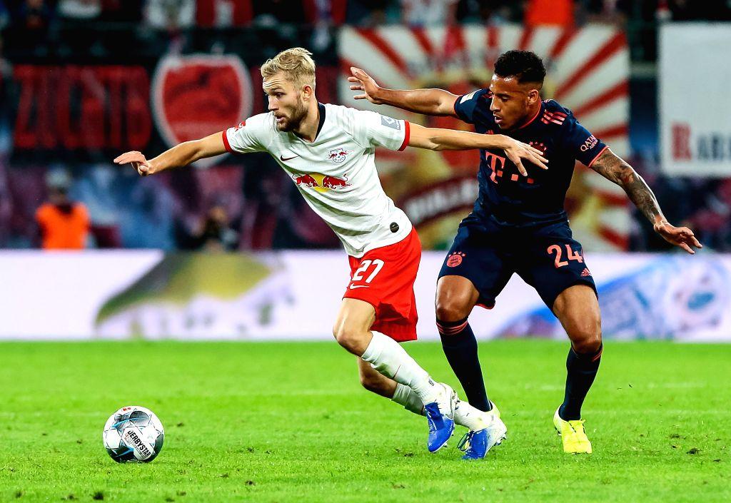 LEIPZIG, Sept. 15, 2019 - Konrad Laimer (L) of Leipzig vies with Corentin Tolisso of Bayern Munich during the Bundesliga soccer match between Leipzig and Bayern Munich in Leipzig, Germany, on Sept. ...