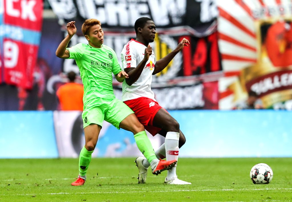 LEIPZIG, Sept. 16, 2018 - RB Leipzig's Ibrahima Konate (R) vies with Hannover 96's Takuma Asano during a German Bundesliga match between RB Leipzig and Hannover 96, in Leipzig, Germany, on Sept. 15, ...