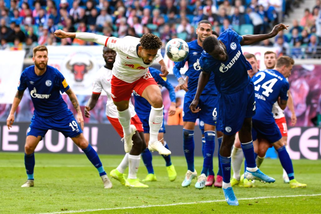 LEIPZIG, Sept. 29, 2019 - Matheus Cunha (L, front) of RB Leipzig vies with Salif Sane (R, front) of FC Schalke 04 during the Bundesliga soccer match between RB Leipzig and FC Schalke 04 in Leipzig , ...