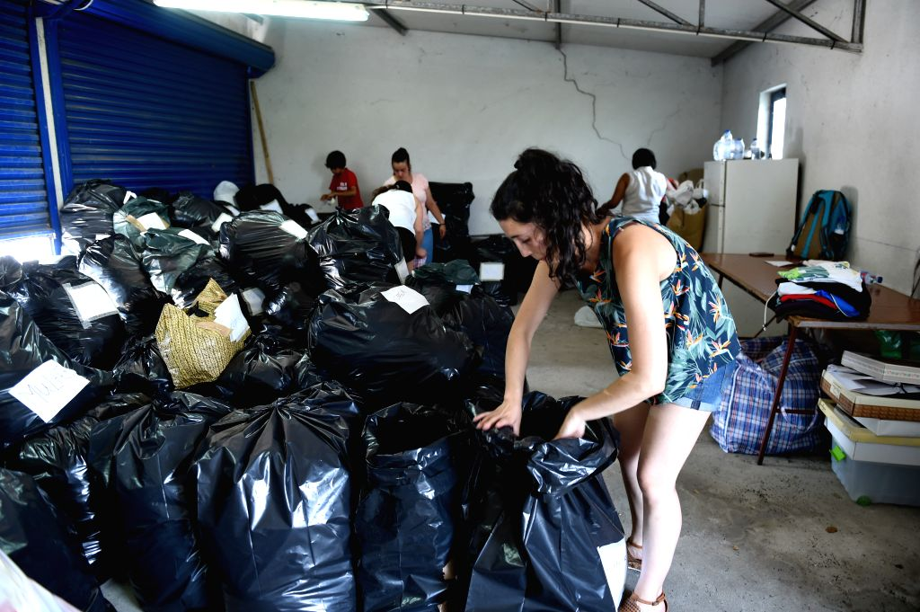 LEIRIA, June 20, 2017 - Volunteers sort out relief supplies at the relief center in Avelar near Leiria, some 200 km northeast of Lisbon, Portugal, on June 19, 2017. By Monday, 64 people including a ...