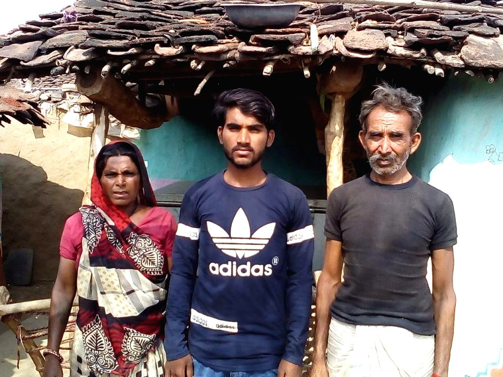 Lekhraj Bheel, with his father Mangilal Bheel and mother Sardari Bai in Mogayabeeh Bhilan village of Rajasthan's Jhalawar district.  He has become the first student of his village to crack IIT. He obtained 10,740 category rank in JEE-Main and is now