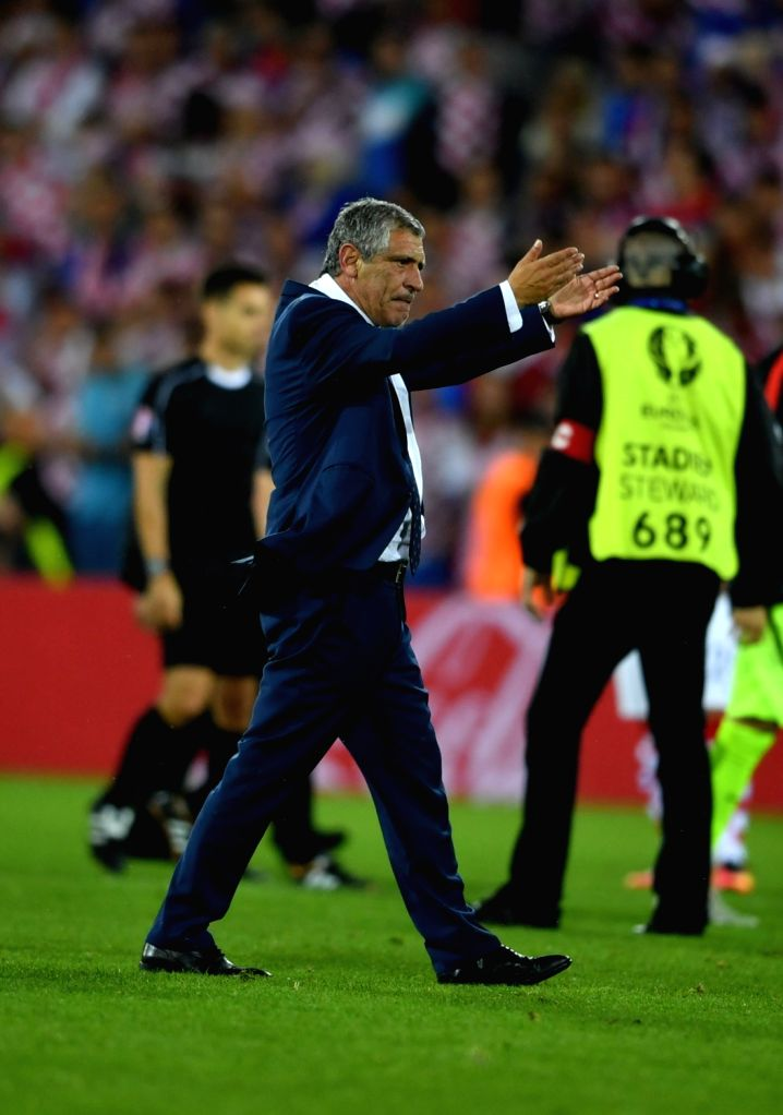 LENS, June 26, 2016 - Fernando Santos, head coach of Portugal celebrates victory after the Euro 2016 round of 16 soccer match between Portugal and Croatia in Lens, France, on June 25, 2016. Portugal ...