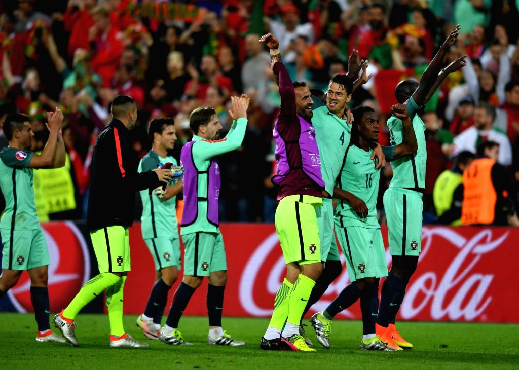 LENS, June 26, 2016 - Players of Portugal celebrate victory after the Euro 2016 round of 16 soccer match between Portugal and Croatia in Lens, France, on June 25, 2016. Portugal won 1-0.