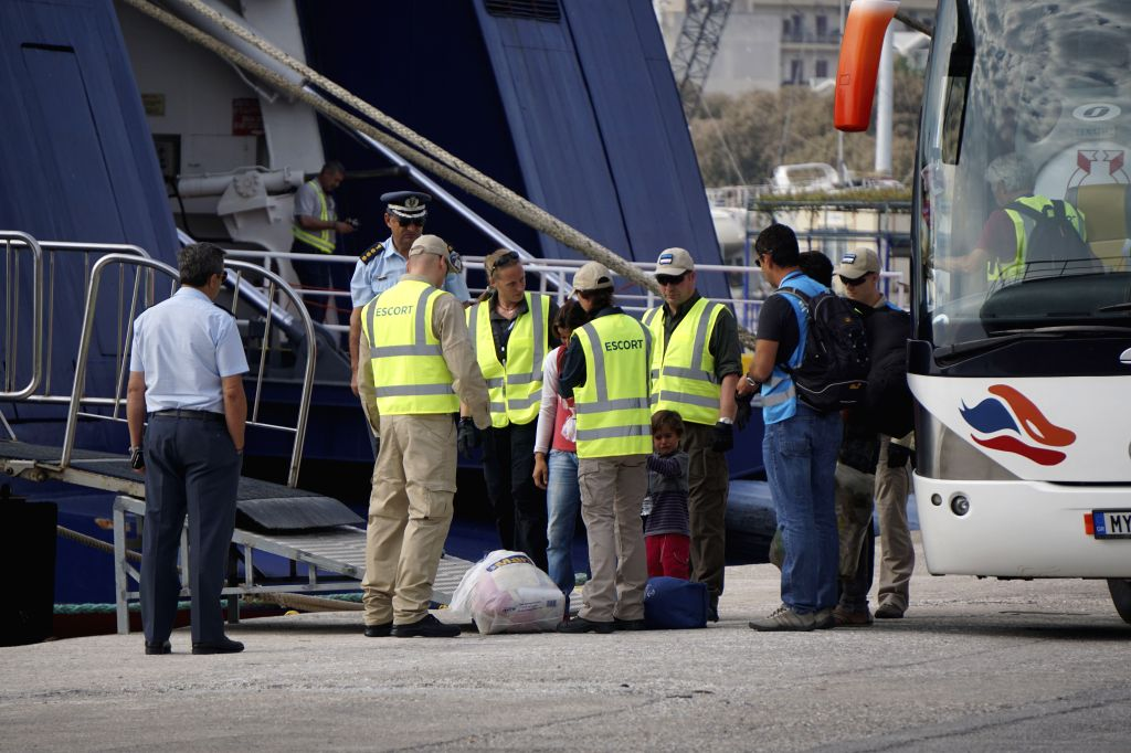 LESVOS, Oct. 6, 2016 - Migrants and refugees get on a ferry to Turkey at the port of Mytilene in Lesvos, Greece on Oct. 5, 2016. A total of 55 migrants and refugees were forced to return from the ...