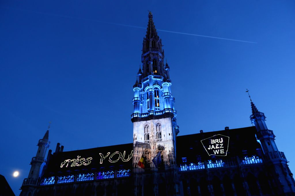 Letters are projected onto the Hotel de Ville at the Grand Place in Brussels, Belgium, July 29, 2020. A sound and light show was held at the Grand Place of ...