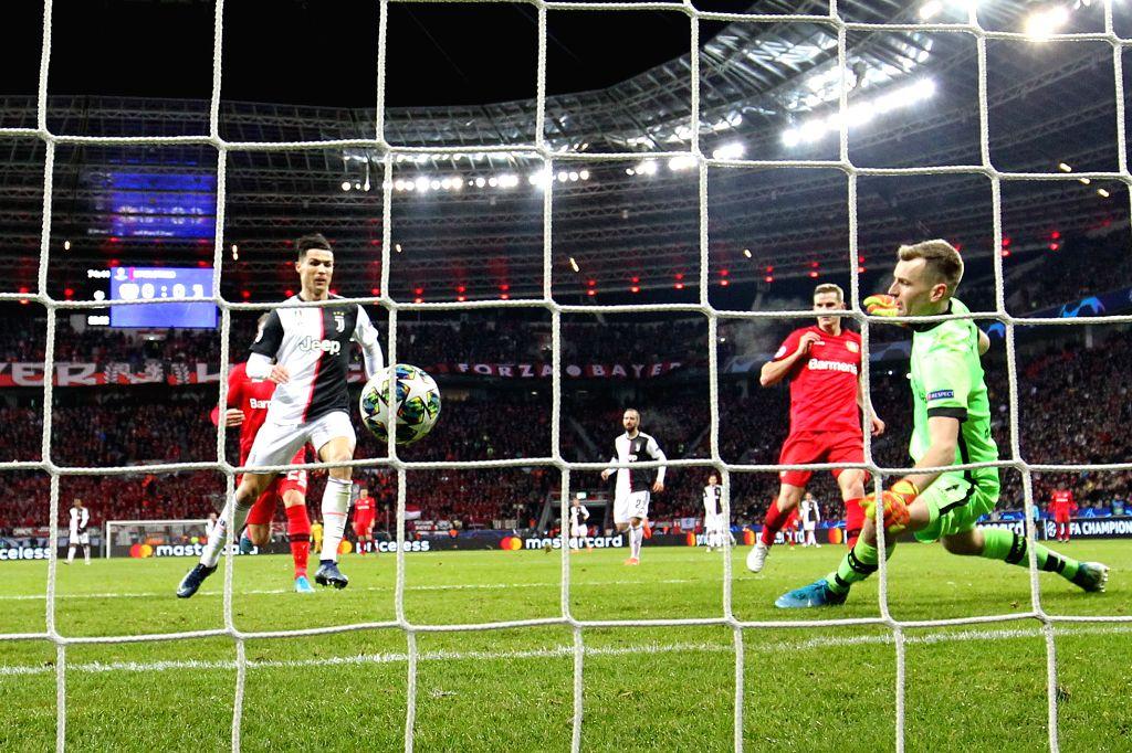 LEVERKUSEN, Dec. 12, 2019 - Cristiano Ronaldo (1st L) of Juventus scores during a UEFA Champions league group D soccer match between Bayer 04 Leverkusen and Juventus FC in Leverkusen, Germany, Dec. ...