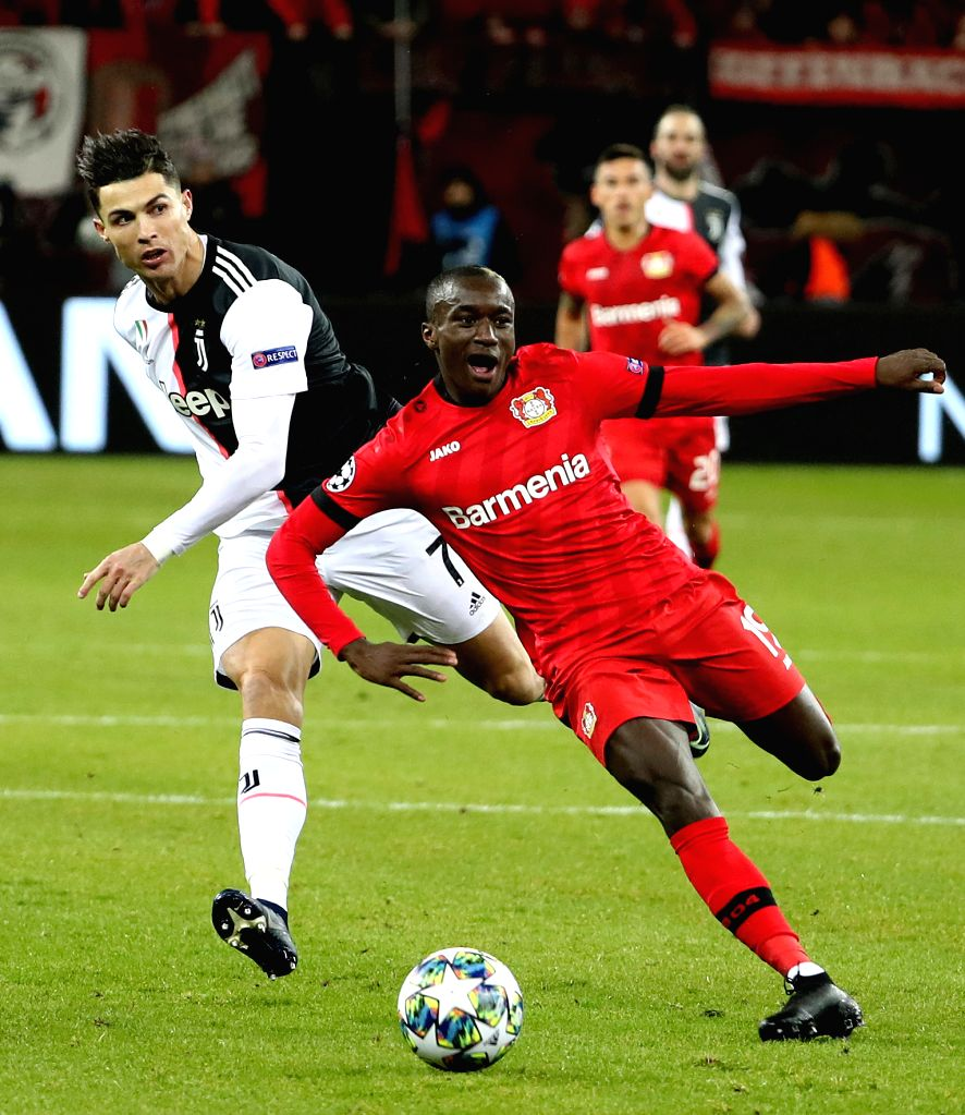 LEVERKUSEN, Dec. 12, 2019 - Cristiano Ronaldo (L) of Juventus vies with Moussa Diaby of Leverkusen during a UEFA Champions league group D soccer match between Bayer 04 Leverkusen and Juventus FC in ...