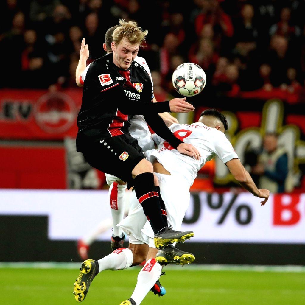 LEVERKUSEN, Feb. 18, 2019 - Julian Brandt (front) of Leverkusen vies with Aymane Barkok (R) of Duesseldorf during the Bundesliga match between Bayer 04 Leverkusen and Fortuna Duesseldorf 1895 in ...